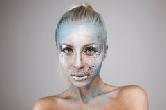 Beautiful blonde girl with bodyart on face  Stock Photo