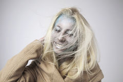 Beautiful blonde girl with bodyart on face  Stock Images