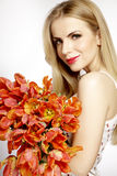 Beautiful blonde girl with the bouquet of tulips isolated on a w Stock Images