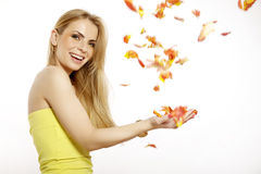 Beautiful blonde girl with the bouquet of tulips isolated on a w Royalty Free Stock Photo