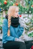 Beautiful blonde girl braids braid, knitted sweater, Winter magic day, the effect retro photo, grain. Beautiful blonde girl braids long braid, knitted sweater Stock Image