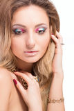 Beautiful blonde girl with bright makeup and long curled hair Stock Images