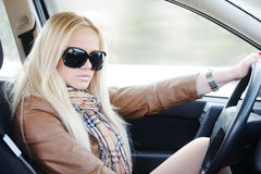 Beautiful blonde girl in car Royalty Free Stock Photos