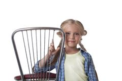 Beautiful blonde girl and chair Royalty Free Stock Photography