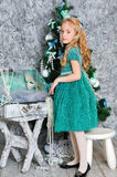 Beautiful blonde girl and Christmas tree Royalty Free Stock Photo