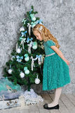 Beautiful blonde girl and Christmas tree Royalty Free Stock Photos
