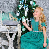 Beautiful blonde girl and Christmas tree Royalty Free Stock Images