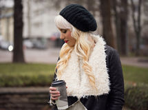 Beautiful blonde girl with coffee. Beautiful blonde woman with coffee outdoors Royalty Free Stock Photos