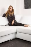 Beautiful blonde girl on the couch Royalty Free Stock Photography