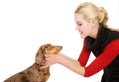 Beautiful blonde girl with dog. Beautiful blonde girl with badger-dog Royalty Free Stock Photography