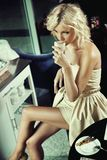 Beautiful blonde girl drinking Royalty Free Stock Images