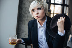 Beautiful blonde girl drinking in cafe Stock Image