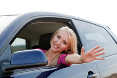 Beautiful blonde girl driver. Beautiful blonde girl driving a car stock photography
