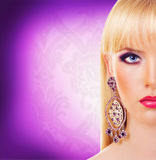 Beautiful blonde girl with earring Stock Photography