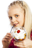 Beautiful blonde girl eating dessert. Isolated over white background stock image