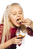 Beautiful blonde girl eating dessert. Isolated over white background royalty free stock image