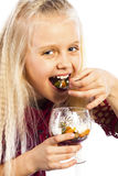 Beautiful blonde girl eating dessert. Isolated over white background stock photos