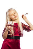 Beautiful blonde girl eating dessert. Isolated over white background royalty free stock photos