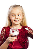 Beautiful blonde girl eating dessert. Isolated over white background stock photo
