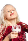Beautiful blonde girl eating dessert. Isolated over white background stock images