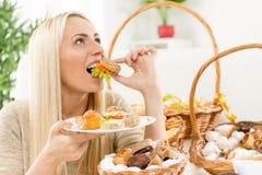 Beautiful Blonde Girl Enjoys Eating Sandwich Royalty Free Stock Image