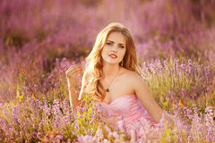 Beautiful blonde girl in a field of lavender Stock Photos