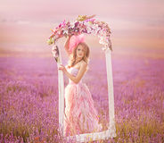 Beautiful blonde girl in a field of lavender Royalty Free Stock Photo