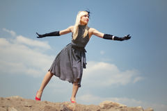 Beautiful blonde girl  flies Stock Images