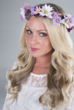 Beautiful blonde girl with flower head piece Stock Images