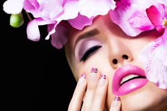 Beautiful blonde girl with flowers and perfect makeup. Beautiful girl with flowers and perfect makeup on black background Royalty Free Stock Images