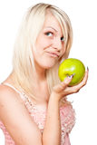 Beautiful blonde girl with fresh green apple Stock Photos