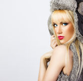Beautiful blonde girl in fur hat Royalty Free Stock Photos