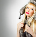 Beautiful blonde girl in fur hat Royalty Free Stock Images