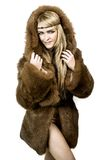 Beautiful blonde girl in fur with hood Stock Photography