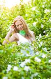 Beautiful blonde girl in the garden Stock Photos