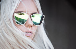 Beautiful blonde girl in green sunglassses outdoor Stock Photo