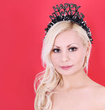 beautiful blonde girl with Happy New Year crown Stock Image