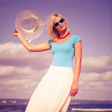 Beautiful blonde girl in hat on beach Stock Photos