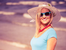 Beautiful blonde girl in hat on beach Royalty Free Stock Photos