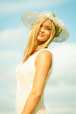 Beautiful blonde girl in hat on beach, summertime Royalty Free Stock Images
