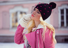 Beautiful blonde girl in hat. Beautiful blonde girl with makeup outdoors royalty free stock images