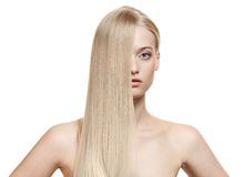 Beautiful Blonde Girl. Healthy Long Hair. Isolated royalty free stock image