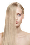 Beautiful Blonde Girl. Healthy Long Hair. Isolated royalty free stock images