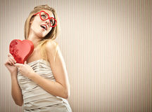 Beautiful blonde girl with heart glasses with chocolate box love gift Stock Photo