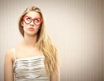 Beautiful blonde girl with heart glasses dream her love Royalty Free Stock Images