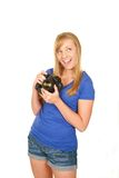 Beautiful blonde girl holding camera Royalty Free Stock Photos