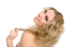 Beautiful blonde girl holding pigtails. Stock Photos