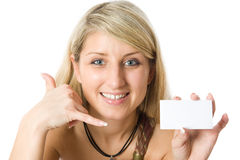 Beautiful blonde girl holding a white card. Stock Photography