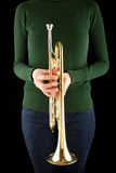 Beautiful blonde girl holds a golden trumpet Royalty Free Stock Image