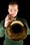 Beautiful blonde girl holds a golden trumpet Royalty Free Stock Images